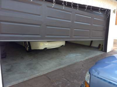 An off-track garage door is not simply unsightly but it may also be quite hazardous and unsteady. You must never try to work on the garage door yourself or ... & Garage Door Off Tracks in Cincinnati? Pezcame.Com